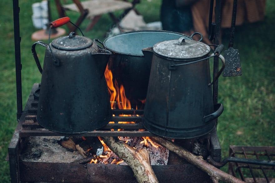 Cowboy coffee brewing over a campfire