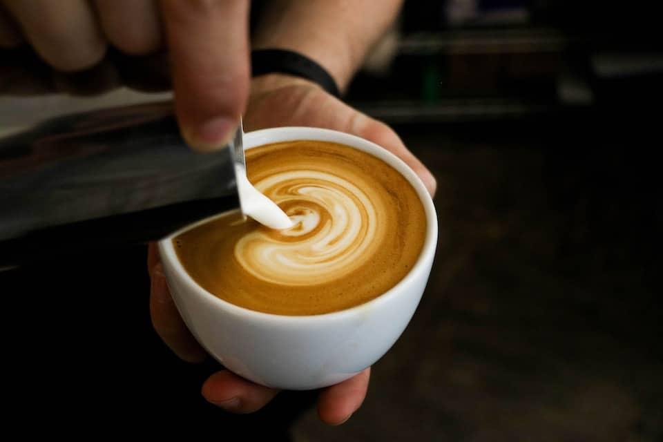 Pouring milk to make a cappuccino