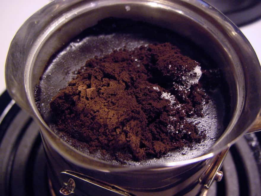 Coffee ground fine as powder is mixed with water in the Cezve.