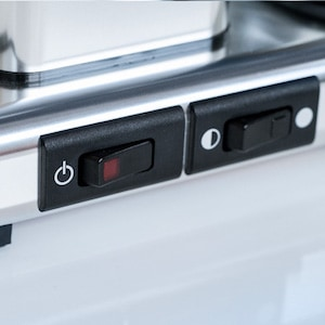 Closeup of the dual-setting hotplate switch on a Technivorm Moccamaster