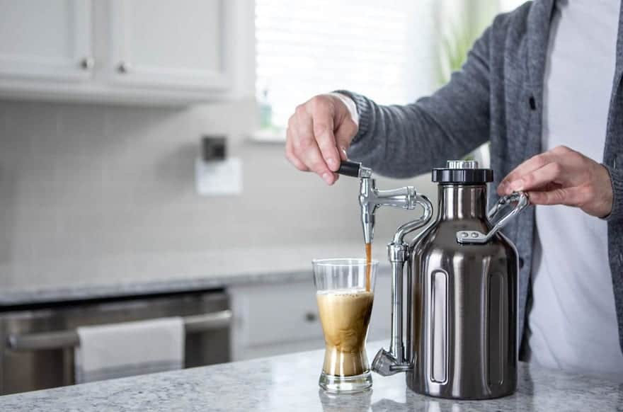Man pouring coffee from UKeg Nitro Cold Brew