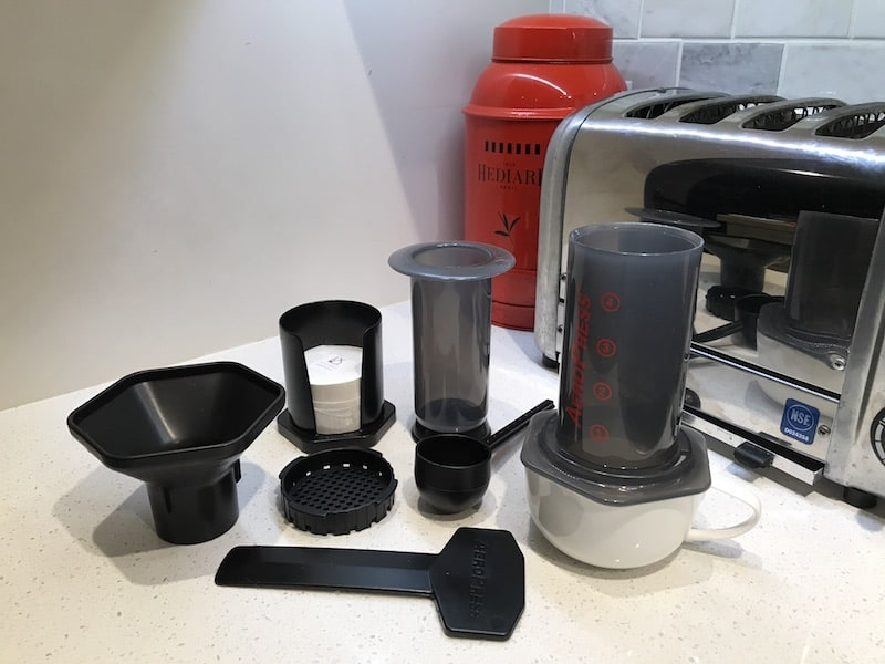 AeroPress parts laid out on a counter
