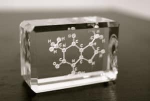 Sculpture of a caffeine molecule suspended in a brick of glass