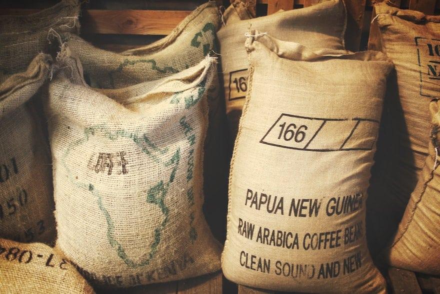 Arabica coffee beans in burlap sacks