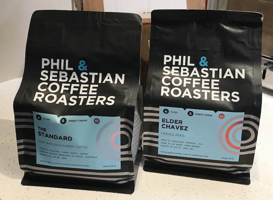 Closeup of two bags of coffee from Phil & Sebastian Coffee Roasters