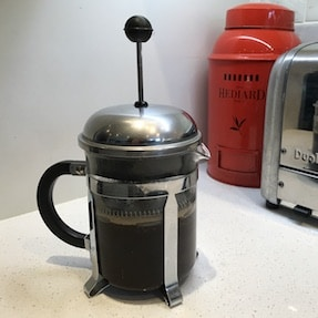 French press coffee steeping on a counter