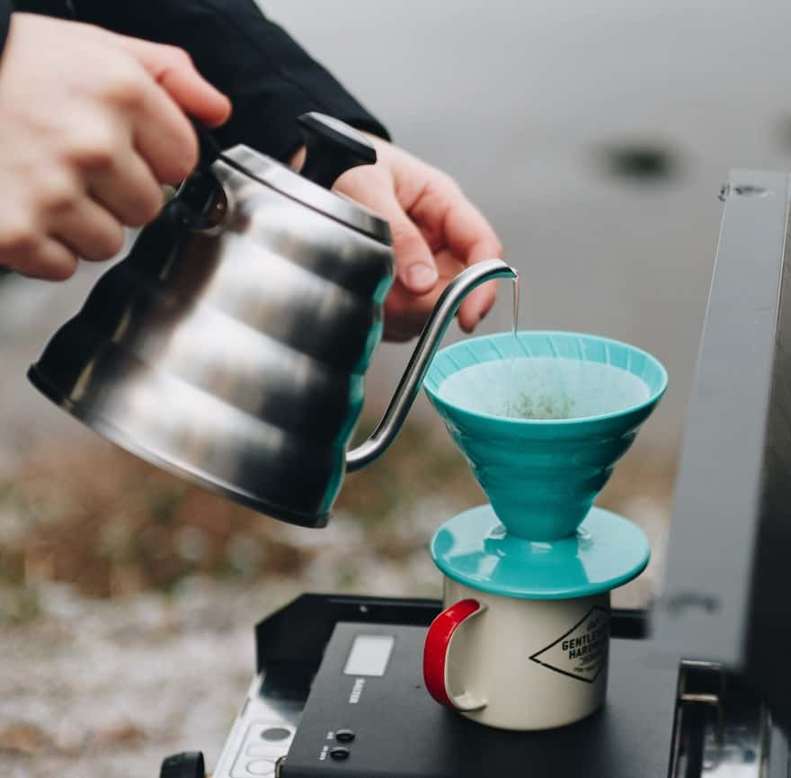 Brewing on a camping stove with a Hario V60 pour-over coffee brewer