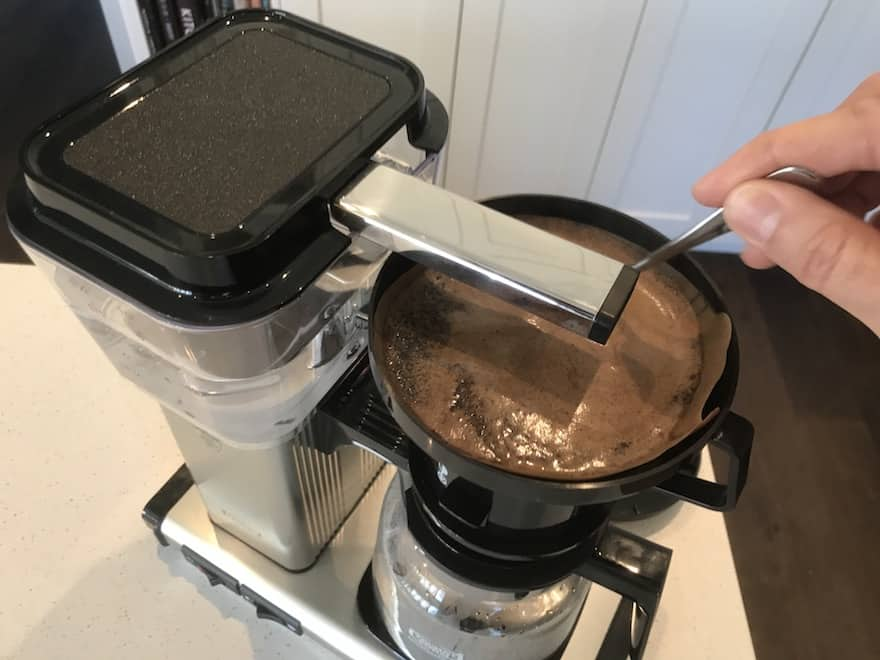 Stirring coffee grounds in Moccamaster brew basket