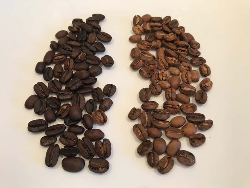 Dark roast coffee beans on the left and blonde roast coffee beans on the right