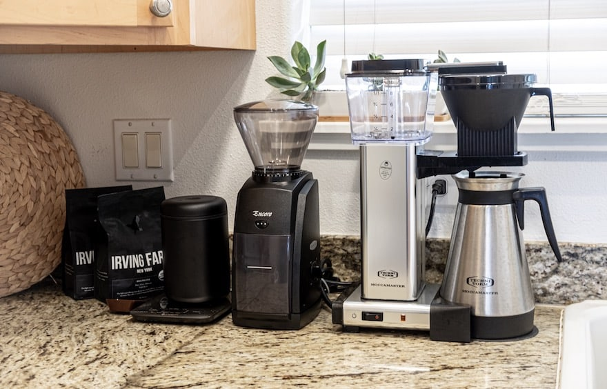 Baratza Encore coffee grinder and Technivorm Moccamaster coffee maker on a kitchen counter