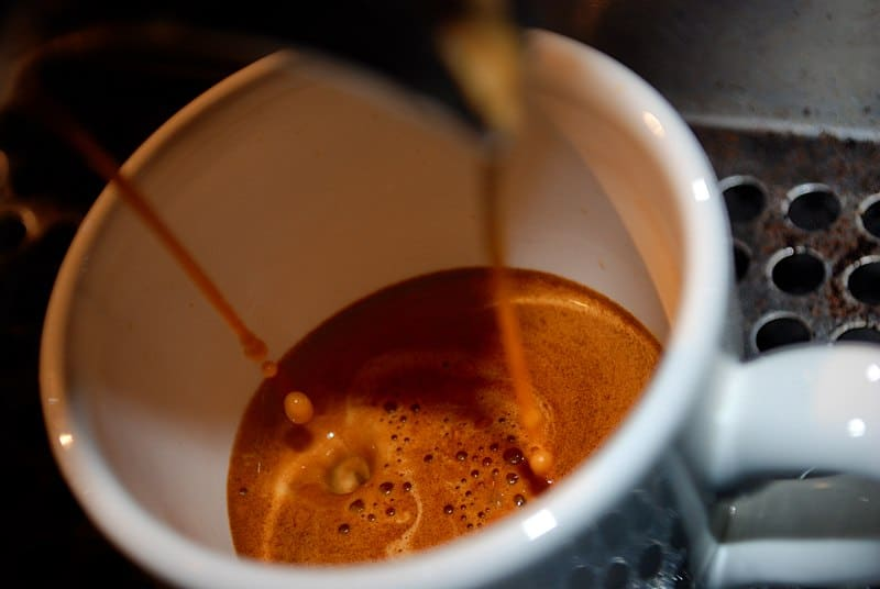 Espresso should be foamy and golden brown as it drops into the cup.