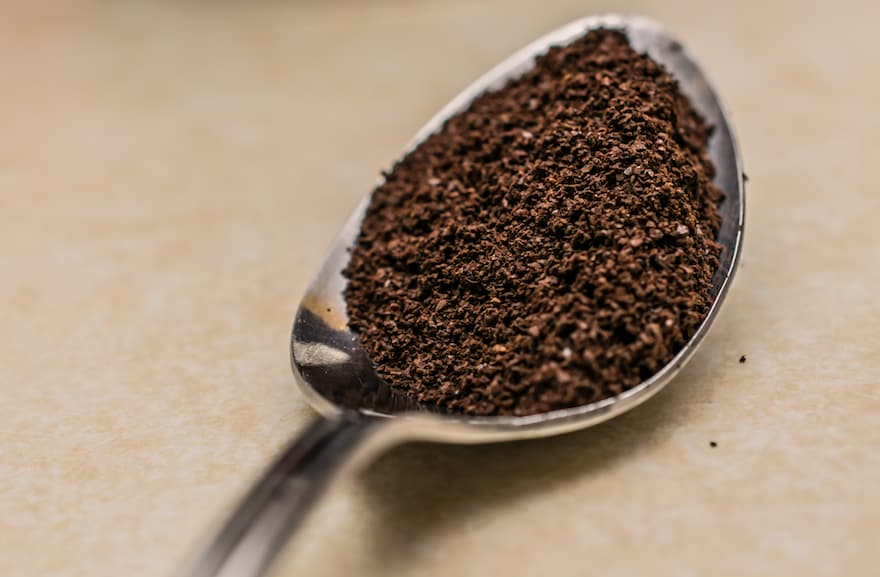 Coffee grounds in a tablespoon
