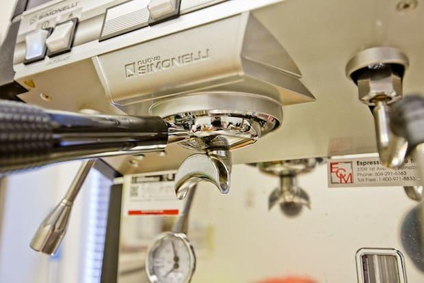 Closeup of the brew group on a Nuova Simonelli espresso machine