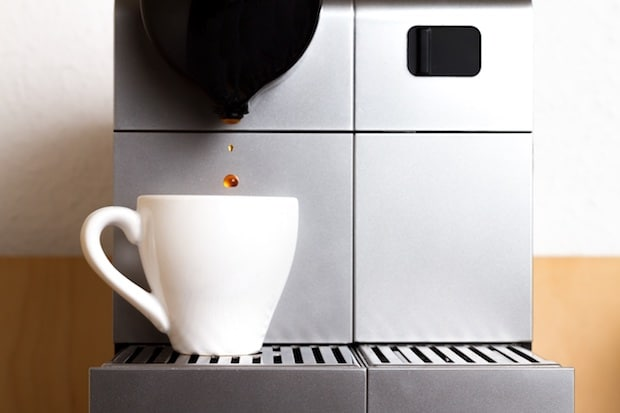 Coffee dripping into a cup from a Nespresso machine