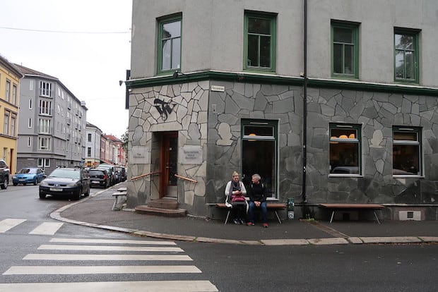 Street corner in Oslo featuring Tim Wendelboe's afe