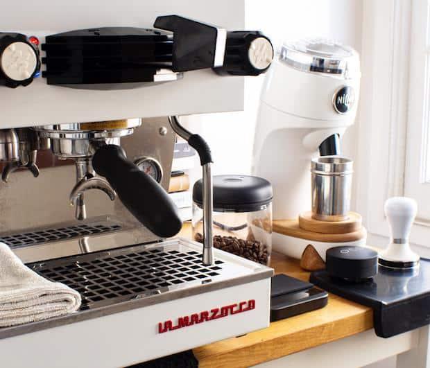 Closeup of a home coffee station featuring a La Marzocco espresso machine