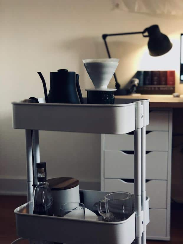 Compact coffee station on a small bar cart