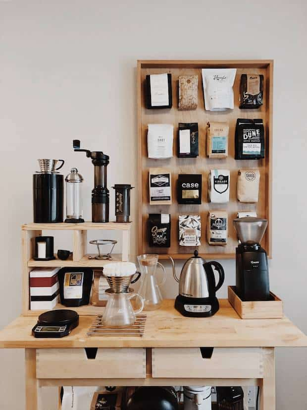 coffee station featuring a crate-like shelving unit on the surface