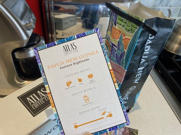 Papua New Guinea coffee and tasting notes card from Atlas Coffee Club