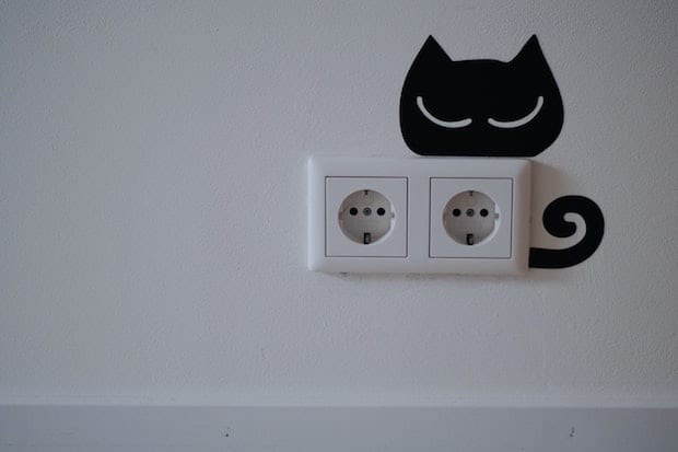 European electrical outlet with three holes aligned horizontally.