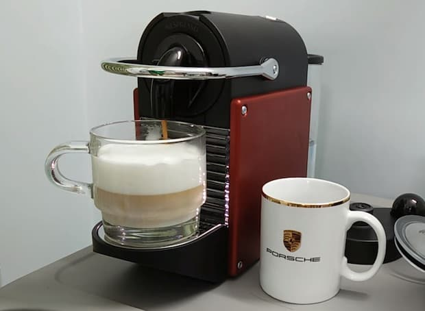 Nespresso Pixie holds a freshly brewed cappuccino